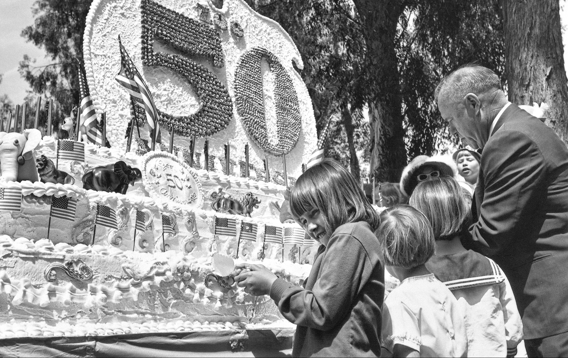 In honor of the Golden Jubilee celebration, a birthday party for the children of San Diego was held at the Zoo on April 3, 1966. A huge birthday cake composed of 314 sheet cakes was set up along the front plaza, and by the end of the day, more than 3,000 pieces of cake had been served to visitors who came to help celebrate. Dr. Schroeder himself (at right) helped to get the party started.